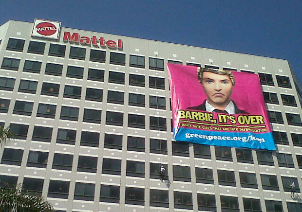 Signs hung on Mattel building in El Segundo by Greenpeace protesting Barbie and Ken